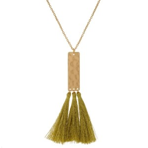 "Long, metal necklace with a hammered rectangle pendant and metallic thread tassels. Approximately 32"" in length."