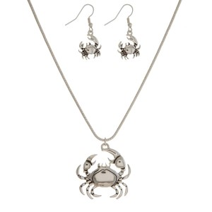"Silver tone necklace set with a sea life pendant and matching fishhook earrings. Approximately 16"" in length."