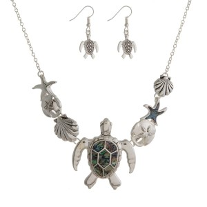 "Silver tone necklace set with abalone sea life pendants and matching fishhook earrings. Approximately 16"" in length."