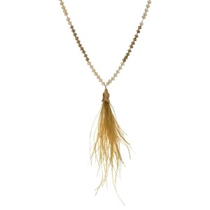 """Full beaded necklace with a feather tassel pendant. Approximately 30"""" in length."""