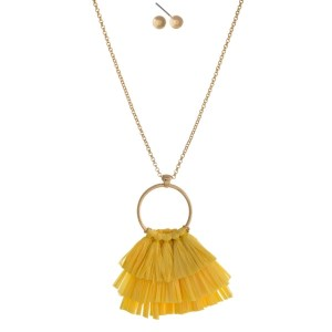 """Gold tone necklace set with a raffia tassel pendant and matching stud earrings. Approximately 32"""" in length."""