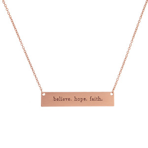 """Dainty metal necklace with a bar pendant, stamped with an encouraging message. Approximately 16"""" in length."""