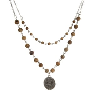 """Two layer, natural stone beaded necklace with a coin pendant. Approximately 16"""" and 18"""" in length."""