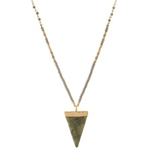 """Gold tone necklace with a triangle shaped, natural stone pendant and beaded accents. Approximately 32"""" in length."""