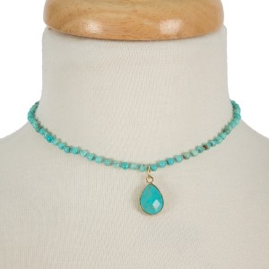 """Short, natural stone beaded choker necklace with a teardrop stone pendant. Approximately 12"""" in length."""