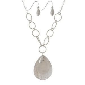 "Short, necklace set with a teardrop pendant and a sea glass accent. Approximately 18"" in length."