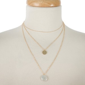 "Dainty, layered metal necklace with circle and pearl pendants. Approximately 14"" to 18"" in length."