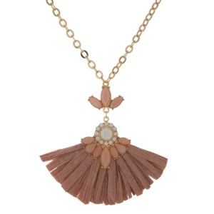 """Gold tone, statement necklace with rhinestone details and raffia fan. Approximately 18"""" long."""