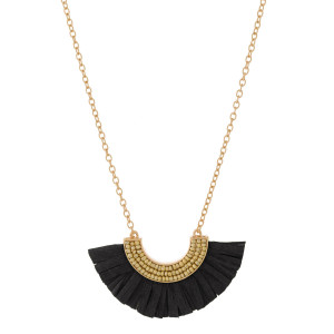 """Gold tone necklace with beaded, raffia accent. Approximately 24"""""""