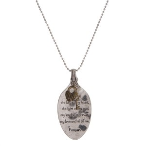 """Burnished silver tone necklace with a spoon pendant stamped with a scripture. Approximately 30"""" in length."""