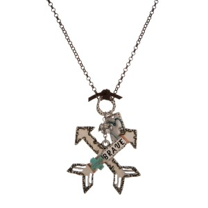 """Burnished metal necklace with a stamped pendant with a turquoise accent. Approximately 32"""" in length."""