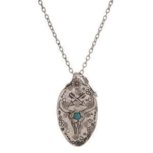 """Long, silver tone necklace with a spoon pendant. Approximately 30"""" in length."""