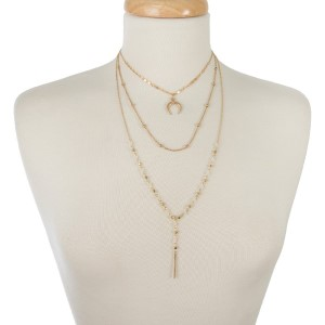 "Dainty gold tone, three layer necklace with faceted beads and a horn pendant. Approximately 14"" to 20"" in length."