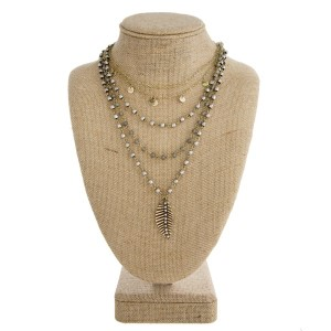 """Short layered necklace with faceted beads and feather pendant. Approximately  20"""" in length."""