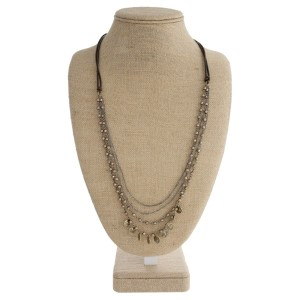 """Long layered necklace with waxed leather cord and coin detail. Approximately 30"""" in length."""