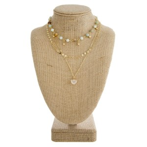 """Layered necklace with natural stone and star details. Approximately 18"""" in length."""