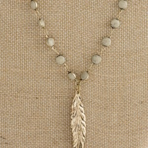 """Long layered necklace with feather pendant. Approximately 24""""-32"""" in length."""