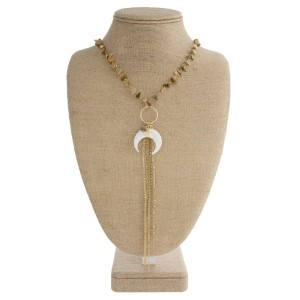"""Gold tone necklace with natural stone beads, horn pendant, and metal tassel. Approximately 32"""" in length."""