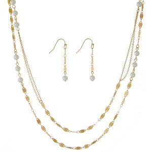 "Long, two layer necklace with pearl beads and matching fishhook earrings. Approximately 28"" in length."