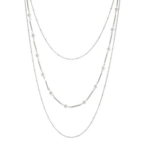 "Dainty necklace set with pearl beaded stationaries and matching stud earrings. Approximately 32"" in length."