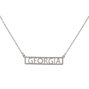 "Dainty necklace with a bar pendant, stamped with state cut-outs. Approximately 16"" in length."