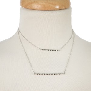 "Dainty, two layer necklace with a bar pendant. Approximately 14"" and 16"" in length."