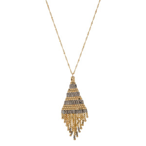 "Gold tone necklace with a metallic beaded pendant. Approximately 32"" in length."