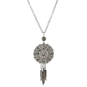 "Long, silver tone necklace with a western pendant. Approximately 30"" in length."