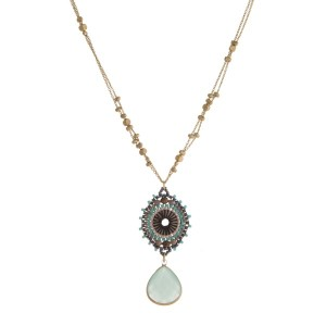 "Dainty, gold tone necklace with a beaded circle pendant and a natural stone pendant. Approximately 24"" in length."
