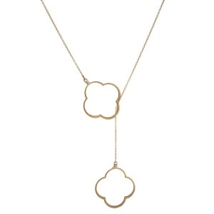 "Long, metal, loop through necklace set with a quatrefoil pendant, matte finish. Approximately 30"" in length."