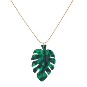 """Gold tone, slide necklace with an acetate, palm leaf shape. Approximately 18"""" in length."""