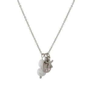 Metal necklace with sea life and pearl pendants.
