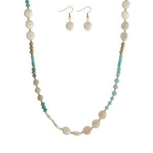 "Long necklace with pearl and faceted beads with matching pearl fishhook earrings. Approximately 24"" in length."