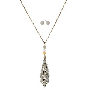 "Long, metal necklace with pearl covered pendant and matching pearl earrings. Approximately 30"" in length."