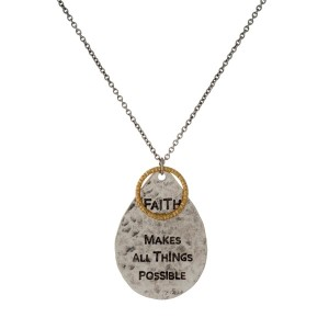 Long, metal necklace with a encouraging message stamped on pendant.