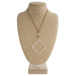 "Suede cord necklace with natural stone and quatrefoil shaped pendant. Approximately 32"" in length."