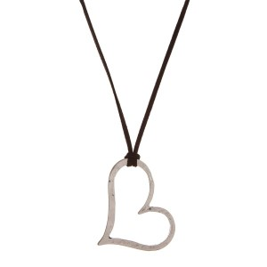 """Long suede cord necklace with a heart pendant. Approximately 30"""" in length."""