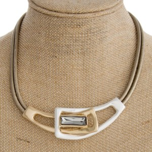 """Waxed leather cord necklace with two tone metal focal and rhinestone detail. Approximately 18"""" in length."""