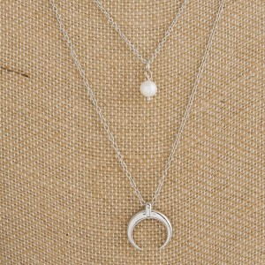 """Layered necklace with moon, pearl and horn accents. Approximately 18"""" in length."""