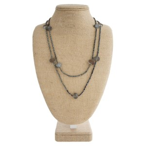"""Long necklace with faceted and oval matte beads. Approximately 34"""" in length."""