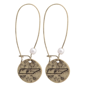 """Burnished gold tone fishhook earrings featuring a disk stamped with the state of Tennessee and a faux pearl accent. Approximately 1 1/2"""" in length."""