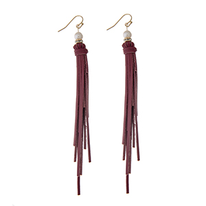 "Red leather tassel earrings with a pave ring and faux pearl accent. Approximately 4"" in length."