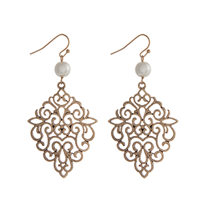 "Burnished gold tone fishhook earrings displaying a filigree design casting with a faux pearl accent. Approximately 2 1/4"" in length."