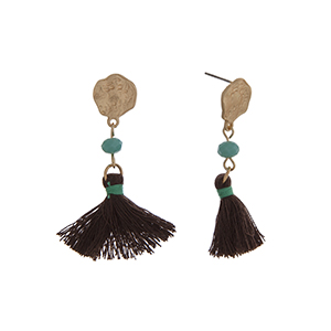 "Matte gold tone drop earrings displaying a turquoise bead with a linked brown tassel. Approximately 2"" in length."