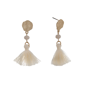 "Matte gold tone drop earrings displaying an ivory bead with a linked ivory tassel. Approximately 2"" in length."