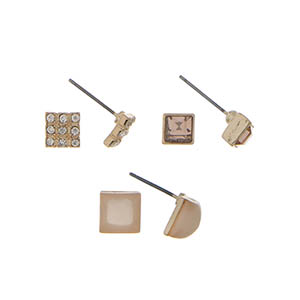 Gold tone three pair stud earring set with light pink stones.