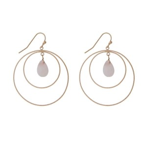 "Gold tone fishhook earrings with a double circle and a blush teardrop stone. Approximately 1.5"" in length."