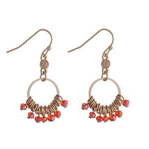 """Gold tone fishhook earrings with red beads. Approximately 1"""" in length."""