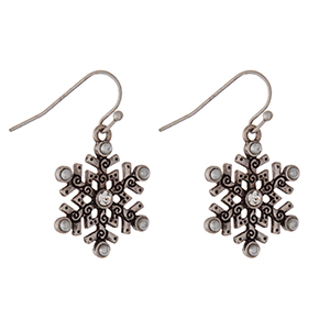 """Silver tone fishhook earrings with a snowflake pendant. Approximately 1"""" in length."""