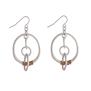 Silver tone fishhook earrings with textured chain and gold tone wire.